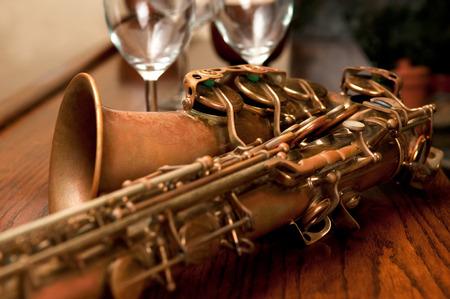 closeup on old, antique alto saxophone on wood bar Stock Photo