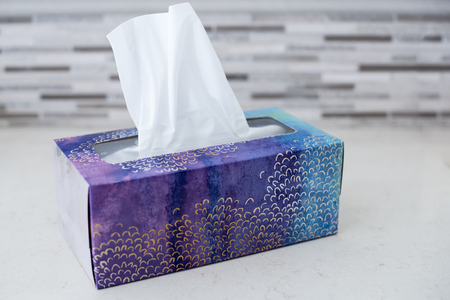 box of tissues on counter in bathroom ready for cold and flu season