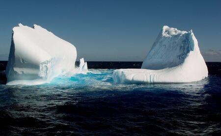 winter escape: Melting iceberg   Stock Photo