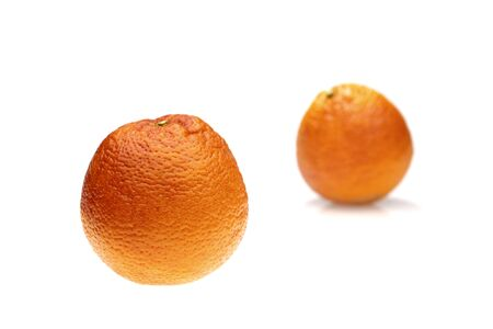 orange peel clove: pair of blood oranges on white background