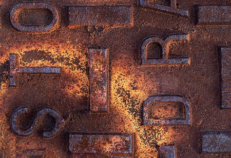 Close up of a rusted, distressed manhole utility cover Stock Photo - 130985663