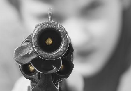 Staring down a loaded gun Stock Photo