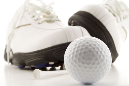 Golf ball with shoes and tee photo