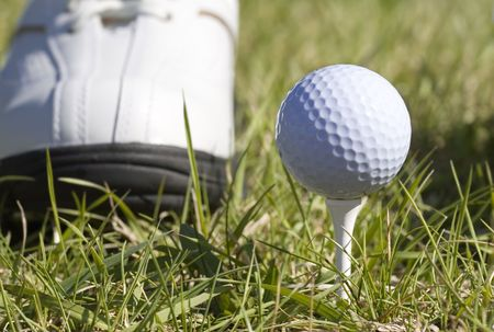 Golf ball sitting on a tee Stock Photo - 396790