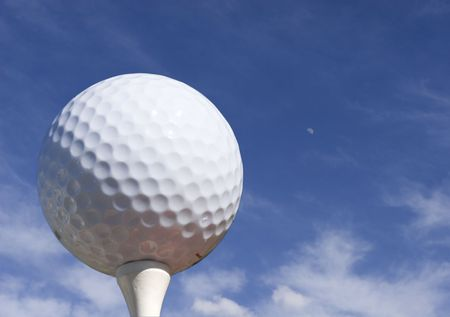 Golf ball with blue sky and moon