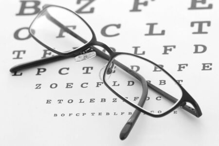 Glasses and eye test chart Stock Photo