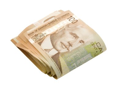 canadian cash: A fold of 100 dollar bills (with clipping path)