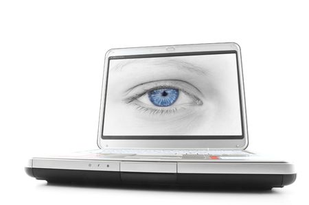 eye pad: Laptop with a picture of a blue eyed female Stock Photo