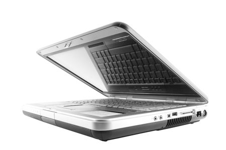 Half open isolated laptop with reflection of keys Zdjęcie Seryjne