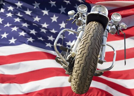 Motorcycle with American flag blowing in the wind
