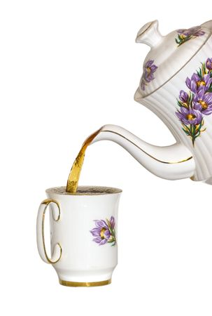 Pouring a cup of tea isolated with clipping path Stock Photo