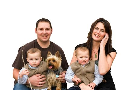 Cut out of a happy family with twin boys and pet dog photo
