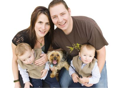 Young family with twin boys and a dog looking up photo