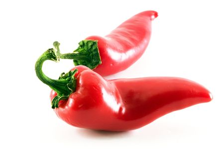 Two red hot jalapeno peppers over white Stock Photo