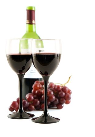 Two glasses of red wine with grapes