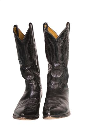 Isolated black leather cowboy boots with pointed toes
