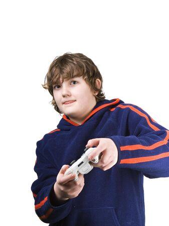 lengua afuera: Chico joven jugando un juego de v�deo con la lengua fuera