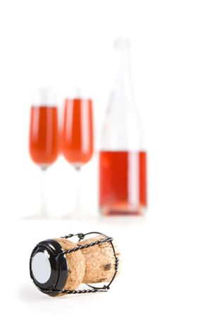 champagne cork with out of focus bottle and drinks in the background(focus on  cork)