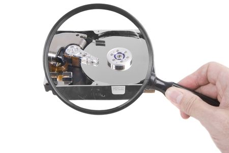 Holding a magnifying glass over a hard drive