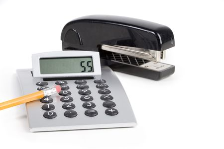 office stapler: Office tools, calculator and stapler over white