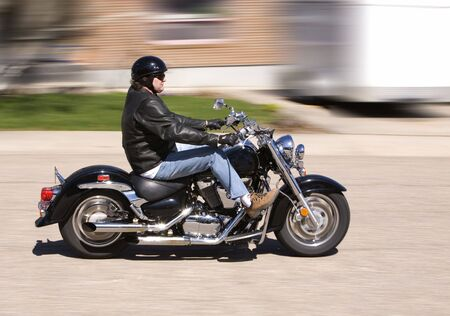 Man enjoying a motorcycle ride in the city (motion blur)