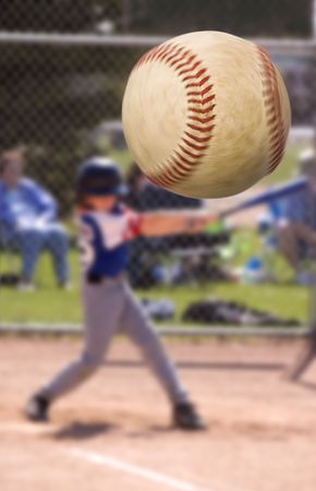 Young baseball player hitting a home run , focus on the ball with motion blur Stock Photo - 945474