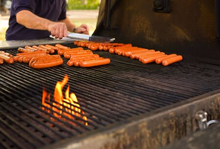 Hot-dogs on a large barbecue outdoors(shallow dof)