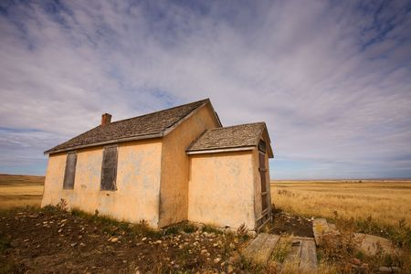 Old abandoned school house on the prairie photo