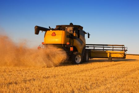 A  combine harvester working a wheat field Stock Photo - 1798361