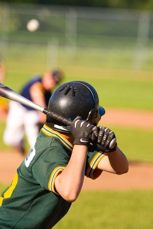 homerun: Young baseball player getting ready to hit the ball Stock Photo