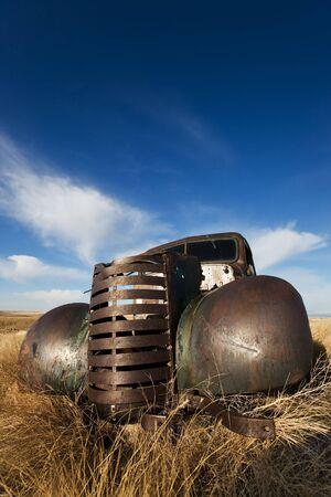 rusting: vintage truck abandoned and rusting away in the prairies