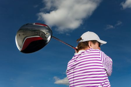 A golfer swinging a large driver (focus on golf club) Stock Photo - 2808060