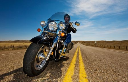 A biker enjoying a ride in the country side Stock Photo