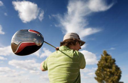 A golfer swinging a large wood (focus on golf club) Stock Photo - 2894559