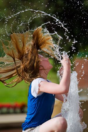 A young girl cooling off on a hot summer day Stock Photo