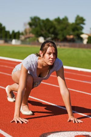 A pretty young woman exercising at the race track Stock Photo - 3479686