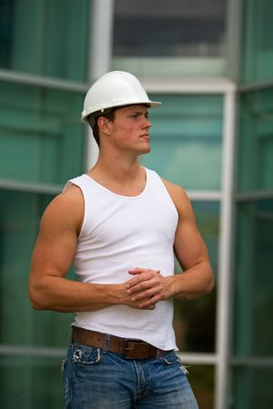 hard: A fit construction worker in jeans and muscle shirt