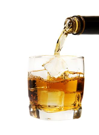 nightcap: A glass of whiskey being poured on a white background