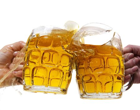 Rowdy: Two people aggressively toasting with beer and breaking a mug Stock Photo