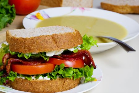 A BLT sandwich and a bowl of split pea soup photo
