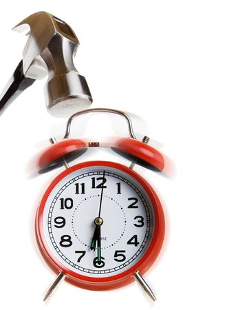 Hammer coming down on a ringing alarm clock