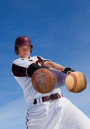 A baseball player taking a swing at a baseball photo