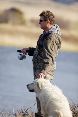 A man and his dog enjoying a day together photo