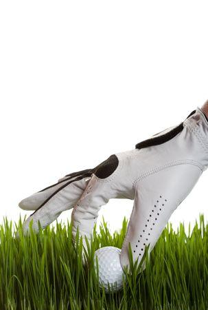 retrieves: A golfer retrieves a golf ball from the long grass on white Stock Photo