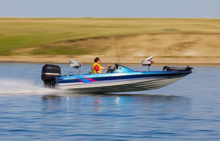 speedboat: fast bass boat speeding to the fishing hole  Stock Photo