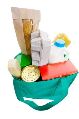 Green eco friendly grocery bag full of food photo