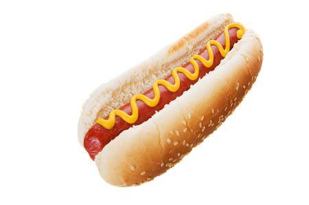 perro comiendo: Perro caliente de Am�rica sobre un fondo blanco