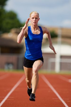 A teen athlete sprinting towards the finish line.