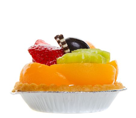 Side view closeup of a glazed fruit tart on a white background photo