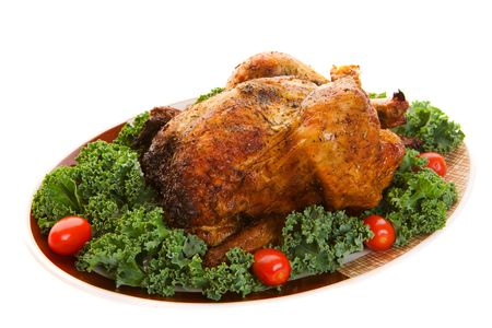 A spicy whole roast chicken on a platter photo